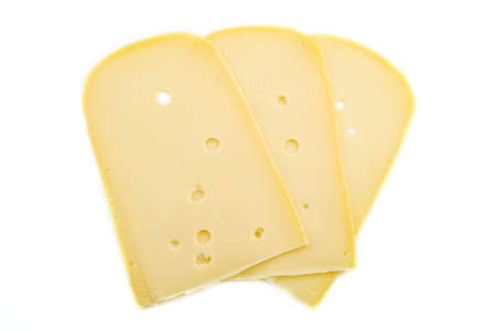 Yellow dutch cheese with holes isolated over white