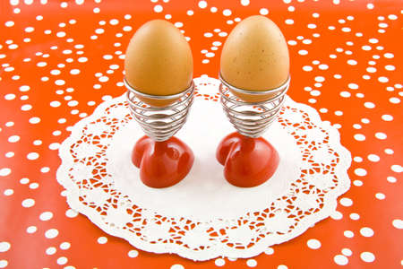 Two eggs in eggcups on a speckles background
