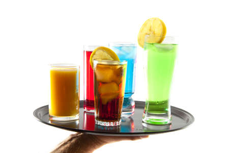 Different kind of drinks on a black tray over white