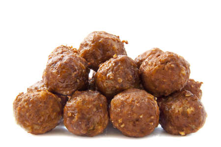 A pile of meatballs isolated over white