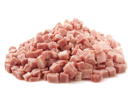 Pieces of ham on a pile isolated over white