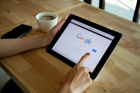 CHIANGMAI,THAILAND - APRIL 19, 2015: Photo of ipad device with a Google search app running