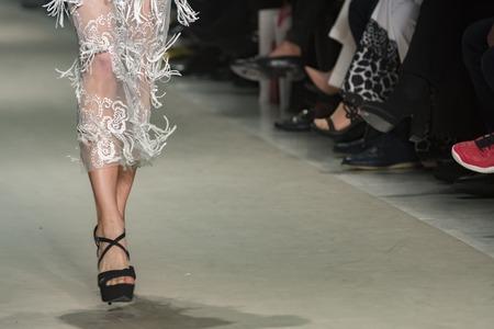 Foto per legs of a model catwalk in fashion show - Immagine Royalty Free