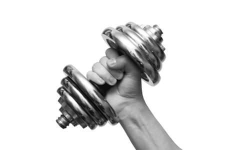 Black and white dumbbells in hand on a white background