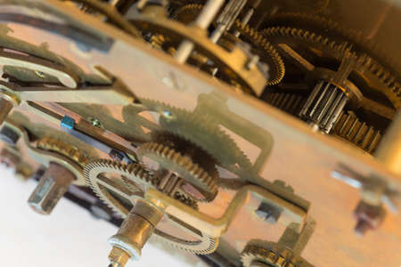 Details of an old swiss automatic clockwork with intricate parts