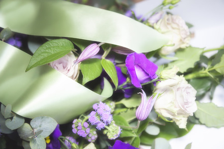 flower arrangement  for funeral with satin ribbons