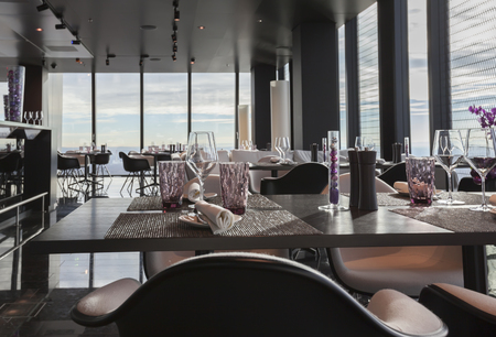 Photo for glasses on empty restaurant table in contemporary restaurant in sky - Royalty Free Image
