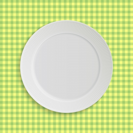 plate on pink square tablecloth