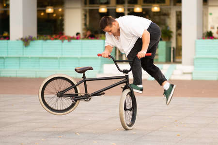 The guy on the stunt bike does the twist of the wheel and does the stunts on the front wheel. For any purpose.