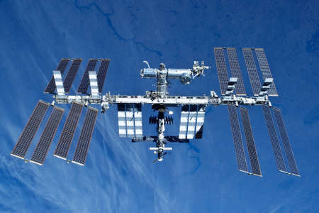 Photo pour Space station on the background of the earth. In expanded form. - image libre de droit