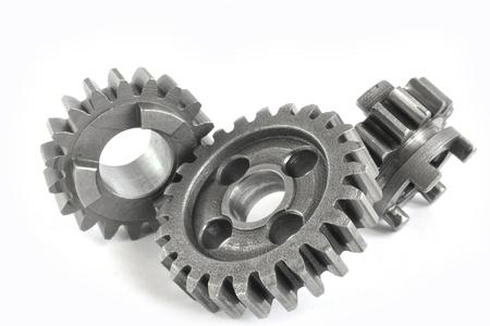 Photo pour Three close-up metal gears on the white background. - image libre de droit