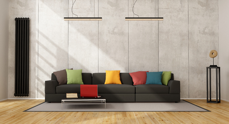 Black sofa with colorful cushion in a concrete room - 3D Rendering