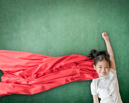 Photo for Superhero Asian school girl kid student with inspiration in women rights in education success concept - Royalty Free Image