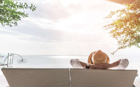 Photo pour Relaxation holiday vacation of businessman take it easy happily resting on beach chair at swimming pool poolside beachfront resort hotel with sea or ocean view and summer sunny sky outdoor - image libre de droit