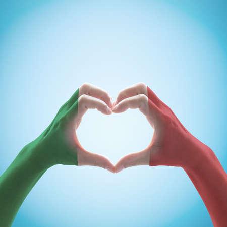 Foto de Italy National flag pattern  on hand heart shape. - Imagen libre de derechos