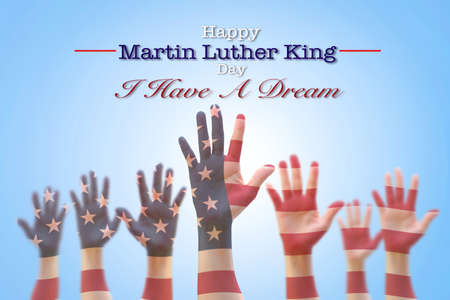 Foto de Happy Martin Luther King day, January 18th, I have a dream with American flag pattern on people hands raising up - Imagen libre de derechos