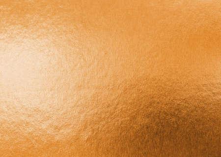 Photo pour Copper gold texture metallic wrapping foil paper shiny orange background for wall paper decoration element - image libre de droit
