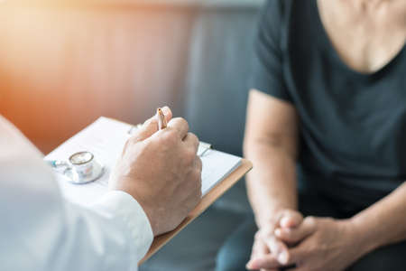 Photo pour Geriatric doctor (geriatrician) consulting and diagnostic examining elderly senior adult patient (older person) on aging and mental health care in medical clinic office or hospital examination room - image libre de droit