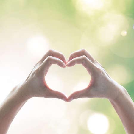 Foto de Hand in heart shape for eco friendly environment CSR in natural resource awareness concept - Imagen libre de derechos