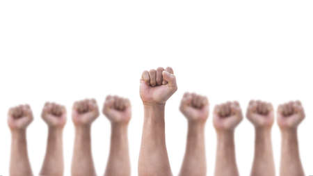 Photo pour Empowering people power, human rights and May day, labor day concept with male clenched fist of man's hand group isolated on a white background - image libre de droit