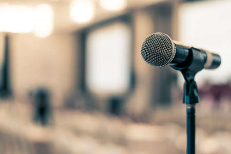 Photo pour Microphone voice speaker in business seminar, speech presentation, town hall meeting, lecture hall or conference room in corporate or community event for host or public hearing - image libre de droit