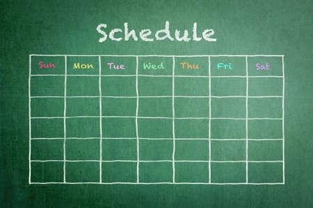 Photo pour Schedule with grid timetable on green chalkboard - image libre de droit