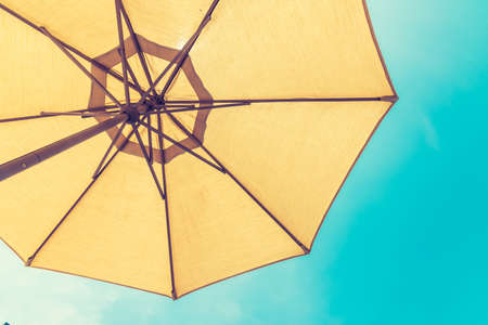Foto de Summer background beach umbrella sunshade uv protection - Imagen libre de derechos