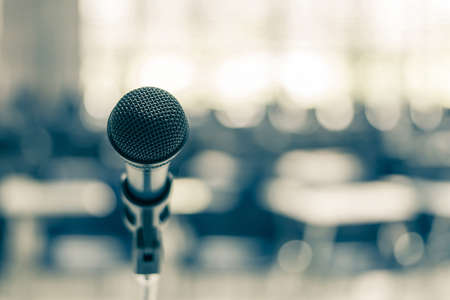 Photo pour Microphone speaker in school lecture hall, seminar meeting room or educational business conference event for host, teacher or coaching mentor - image libre de droit