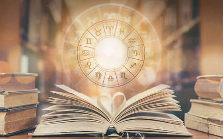 Photo for Love horoscope, zodiac sign astrology for foretell and fortune telling education study course concept with horoscopic wheel over old love story book in school library - Royalty Free Image