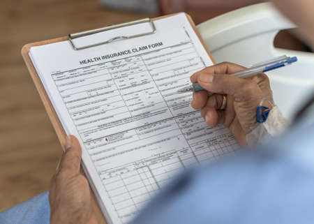 Photo pour Health insurance claim form application for medicare coverage and medical treatment for patient with illness, accident injury and admitted in hospital ward - image libre de droit