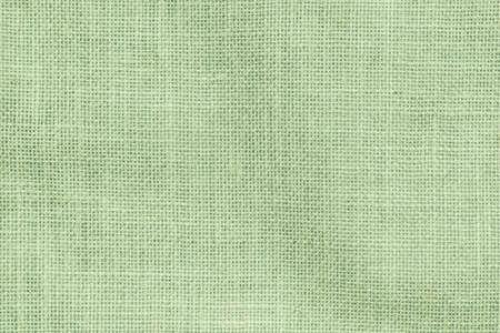 Photo pour Hessian sackcloth woven texture pattern background in light pale green earth color  - image libre de droit