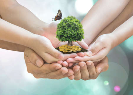 Foto de Retirement planning, family financial investment and legacy concept with father parent support children's hands growing tree with wealthy gold coins - Imagen libre de derechos