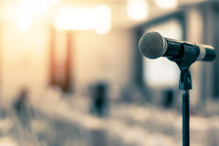 Photo pour Microphone voice speaker in business seminar, speech presentation, town hall meeting, lecture hall or conference room in corporate or community event for host or townhall public hearing - image libre de droit