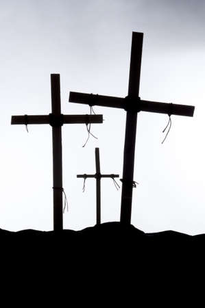 Shadow and silhouette of the crucifixion on a white background