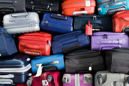 Photo pour Suitcases multicolor stacked for transport one above the other - image libre de droit
