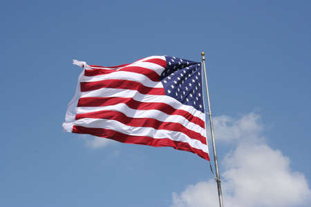 An American flag blows wildly in the wind.