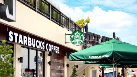 BANGKOK, THAILAND - JUNE 28, 2015: A new branch of Starbucks coffee available in Bangkok, Thailand. Starbucks is the largest coffee franchises in the world, currently.