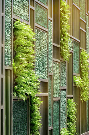 Green Wall with Vertical Demo Gardenning in Warm Light Tone.