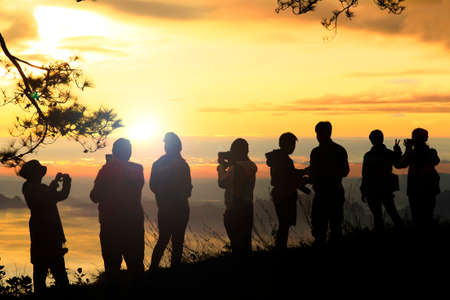 People enjoyed sunrise at the mountain top.