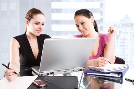 Two businesswomen having a meeting at the office