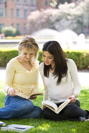A shot of two college students studying and having a discussion on campus
