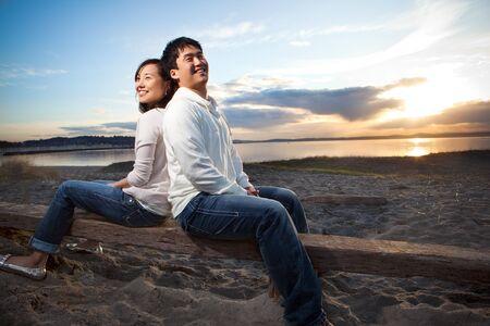 Photo pour A portrait of an asian couple having fun outdoor - image libre de droit