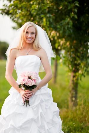 A shot of a beautiful caucasian bride outdoor