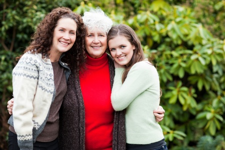A multi generation portrait of a happy grandmother with her daughter and granddaughter
