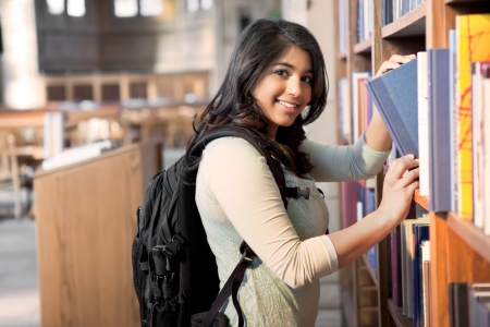 A shot of an asian student getting books in a library