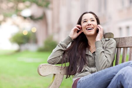A shot of an ethnic student talking on the phone