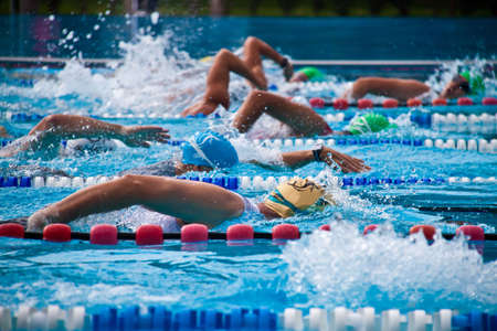 Photo pour Crawler during a competition in a swimming pool - image libre de droit