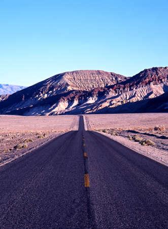 Long straight road through Death Valley, California, USA