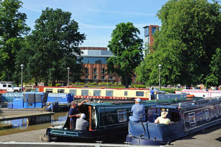 Stratford-upon-Avon, UK - May 18, 2014 - Royal Shakespeare Theatre with narrowboats in the foreground, Stratford-upon-Avon, Warwickshire, England, UK, Western Europe