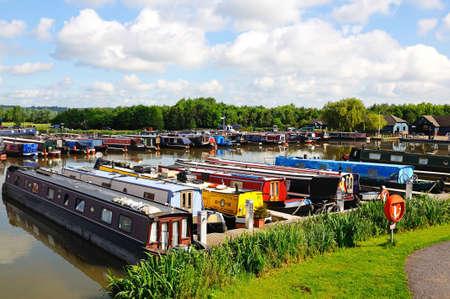 Barton-under-Needwood, UK - May 21, 2014 - Narrowboats on their moorings in the canal basin, Barton Marina, Barton-under-Needwood, Staffordshire, England, UK, Western Europe